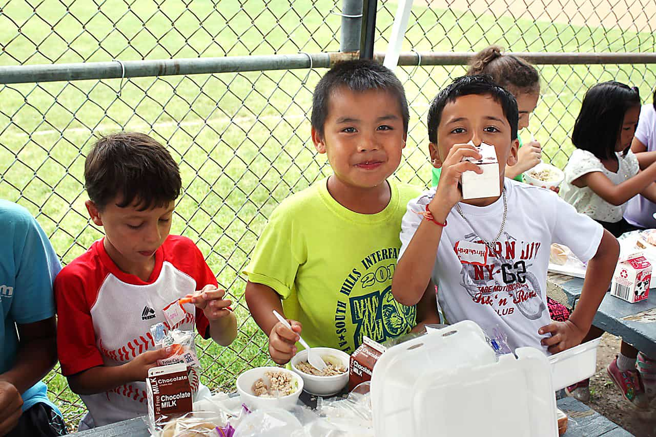 Community children eating free lunch
