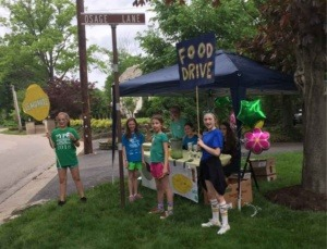 Kids at a lemonade stand for SHIM