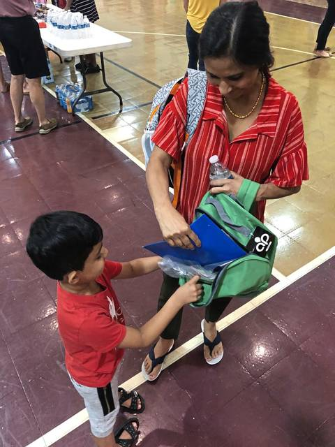 Mom and son pack new book bag at back-to-school event at SHIM