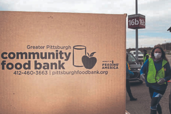 Boxes of food loaded into cars at food distribution
