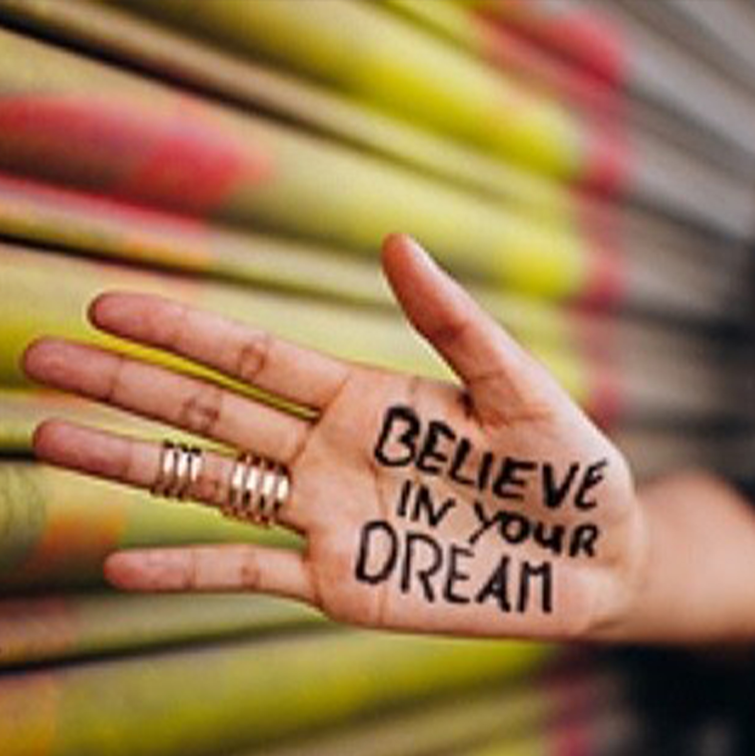 Hand with the words Believe in your dream written on it