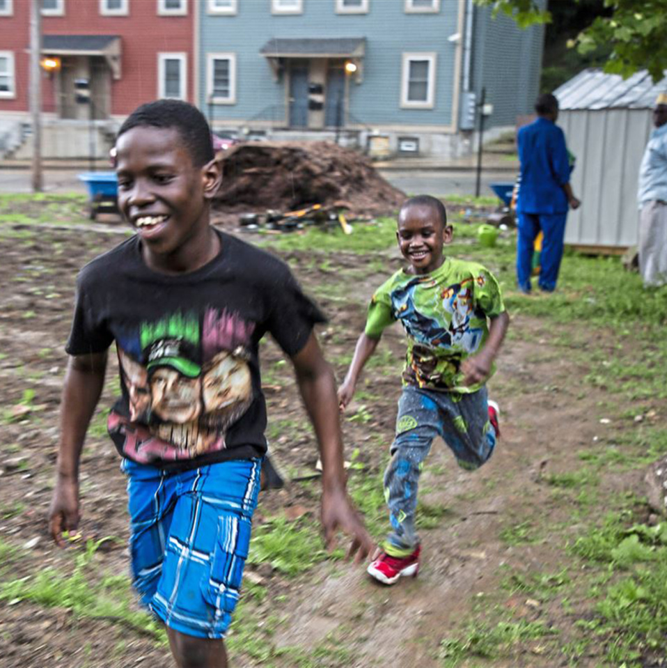 Two children running in a lot
