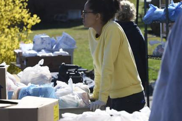 Volunteer helps sort food donations