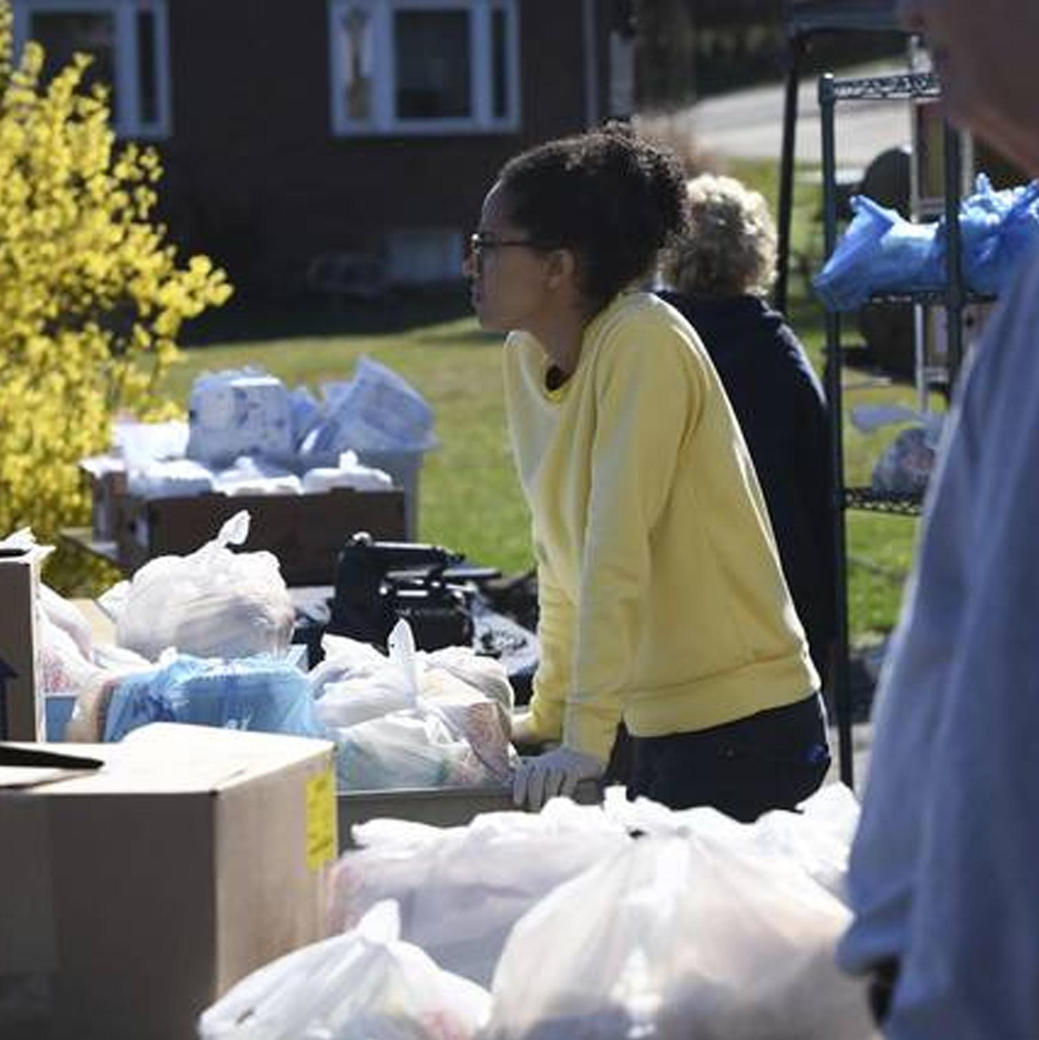 Volunteer helps sort food donations