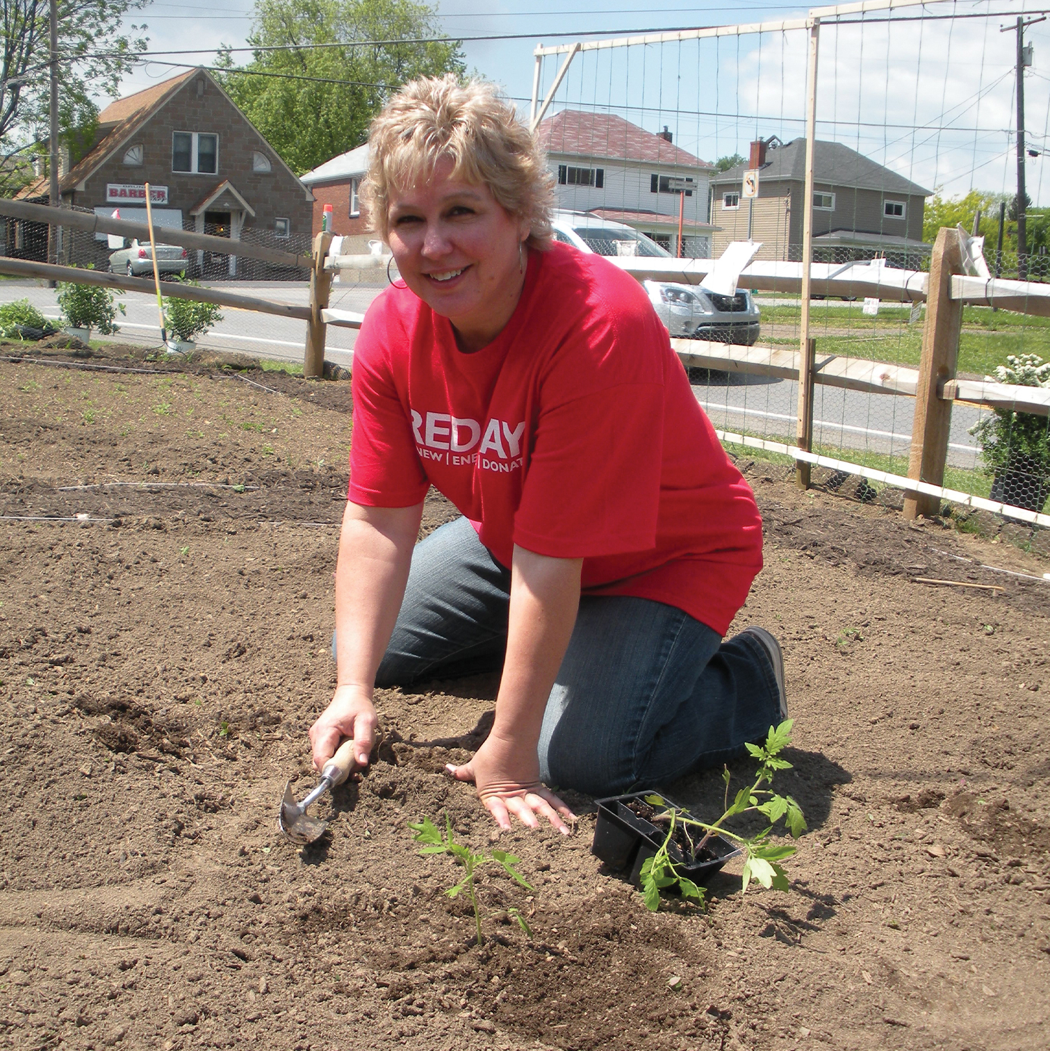 SHIM volunteer working in the garden
