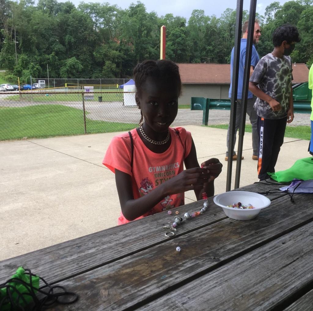 Beading girl at camp