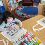 Girl coloring for kindness