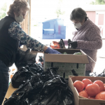 Pantry volunteers with produce