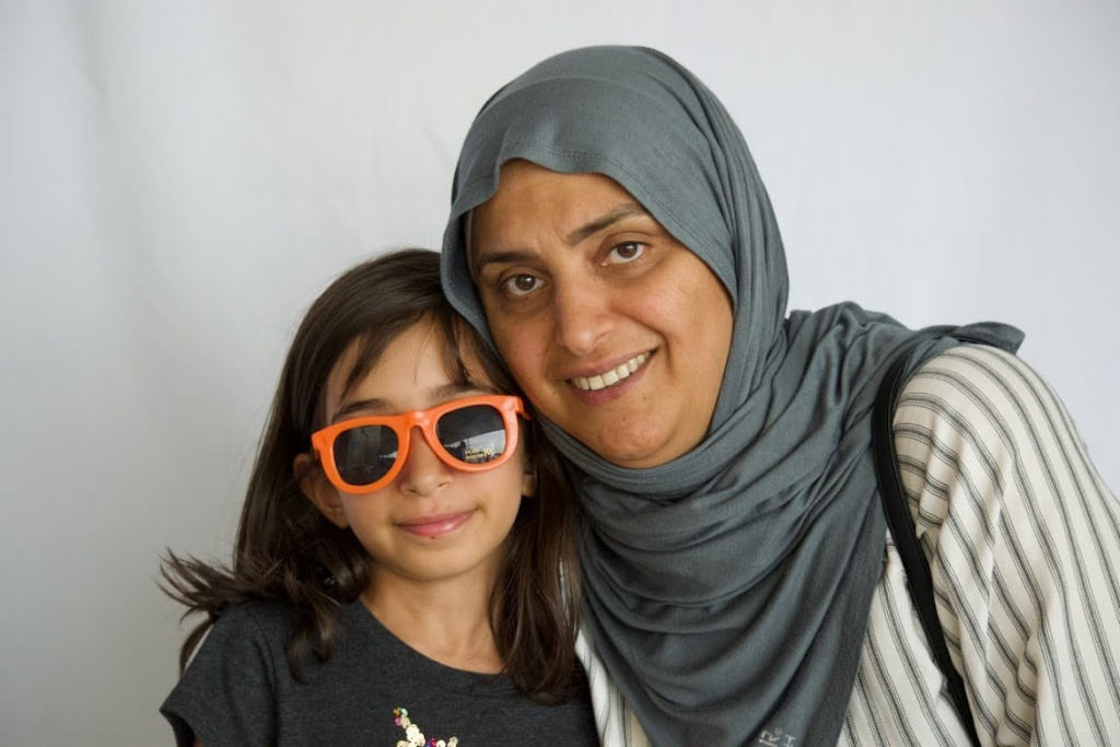 Woman with girl in sunglasses
